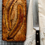 A golden brown loaf of healthy banana bread. recipe in post!
