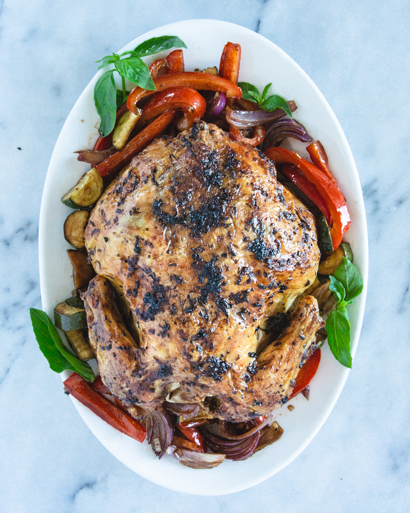 This easy whole roasted chicken recipe is packed with summer flavor. #oven #inagarten #recipes #leftovers #lemon #herbs #best #seasoning #garlic