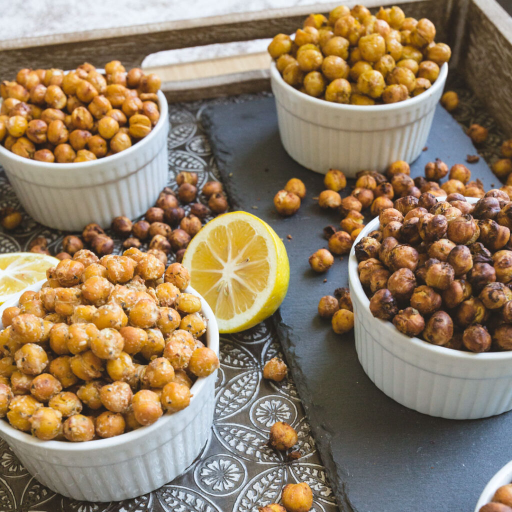 Air fryer roasted chickpeas in bowls on a tray