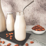 A milk bottle filled with dairy free homemade almond milk