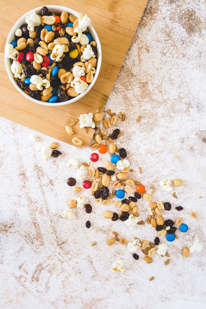 sweet and salty trail mix spilling out of a bowl